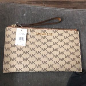 Brand new Michael kors large zip clutch